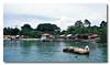 A series of kampong houses fronting the sea leading to the jetty. Pulau Ubin.