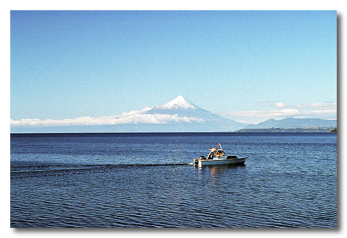 A spectacular view of the snow-capped volcano Osorno across lake Llanquihue (which is bigger than Singapore). Puerto Varas, Chile.