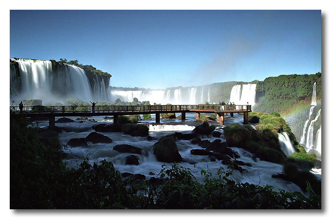 A walkway cuts across the rapids, taking you to the very edge of the falls. Iguaçu Falls, Brazil.