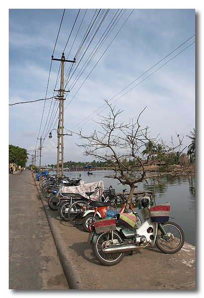Bikes along Thu Bon river. Hoi An, Vietnam.