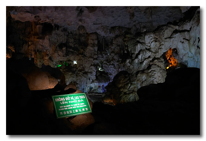 "The sign says ""Not allowed to climb up, write down and draw into the stalactite"". Halong Bay, Vietnam."