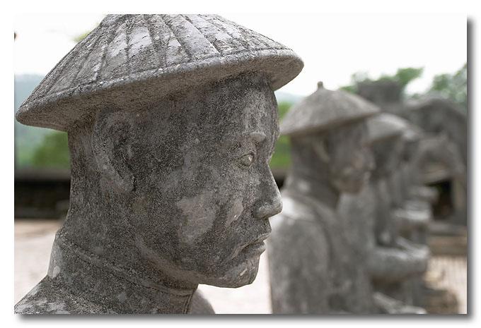 Military mandarins on guard. Khai Dinh's Tomb, Hue, Vietnam.