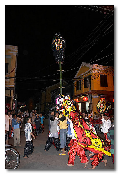 I don't know what the ocassion was but lots of kids were out that night, performing lion dances at major cross junctions. Hoi An, Vietnam.