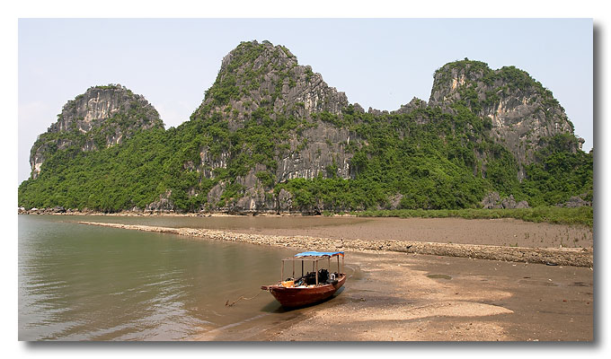 A lonely boat. Halong Bay, Vietnam.