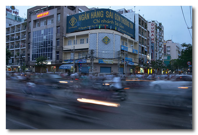 Crossing the road is always a challenge in Vietnam. Ho Chi Minh City (Saigon).