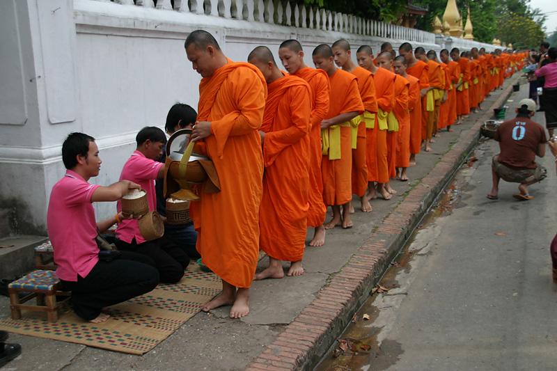 Collecting alms.  Luang Prabang, Laos.