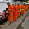 Collecting alms.  Luang Prabang, Laos.