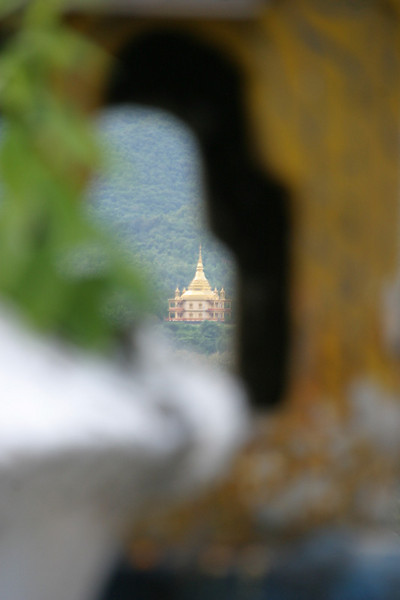 Temple in the distance.<br /> <br /> I'm not sure which temple this is but it was shot from the top of Phou Si, the main hill in Luang Prabang.