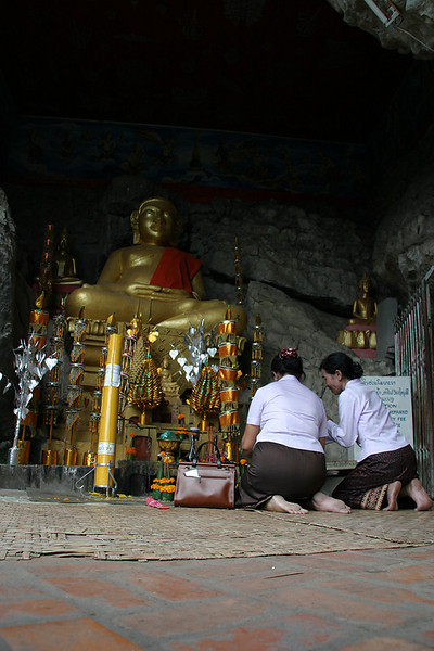 Prayers at Phou Si, Luang Prabang, Laos.