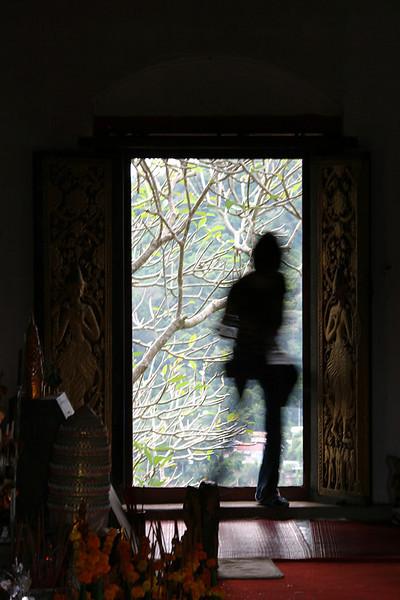 Chelsea walking through the door.  Phou Si, Luang Prabang, Laos.