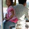 Cute daughter of the boatman.  Luang Prabang, Laos.