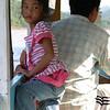 Cute daughter of the boatman.  Luang Prabang, Laos.