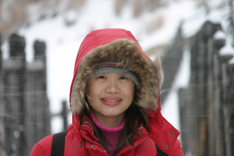 """Smile!  You can see the snow blowing across her face.  Jigokudani or """"Hell Valley""""."""