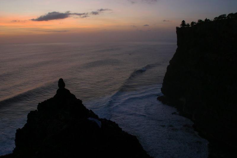Sunset at Uluwatu.  Can you see the silhouette of a monkey? Bali, Indonesia.