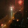 Pretty soon, the entire street was very smoky with fireworks going off everywhere.  Shanghai, China.