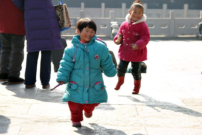 Kids having fun outside Ru Xing Men.  Nanjing, China.