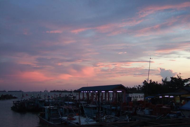 Sunset at the small fishing port at Pengarang, Malaysia.