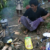 Our head chef frying some eggs.  Mount Rinjani, Lombok, Indonesia.