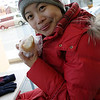 Wifey enjoying a fish cake thingy. Otaru.
