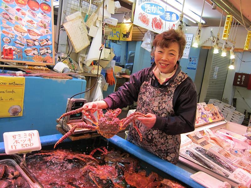 "Smile! ""You buy my crab?"". Otaru Chuo Market"