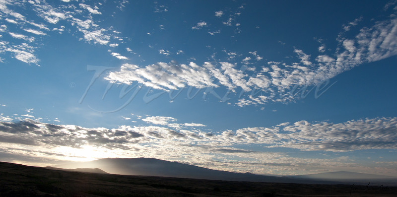 Three Mauna. Left slope to Kohala. Mauna Kea behind pu'u. Mauna Loa distant right.