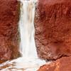Cascade in red (Kauai, Waimea Canyon, 2010)