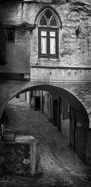 Passage under a gothic window