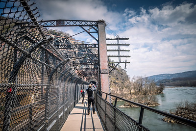 Harper's Ferry WV - Train Bridge over the Potomac River with tunnel going through the Maryland Heights.