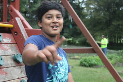 krishav smileing and pointing to someone on the playground