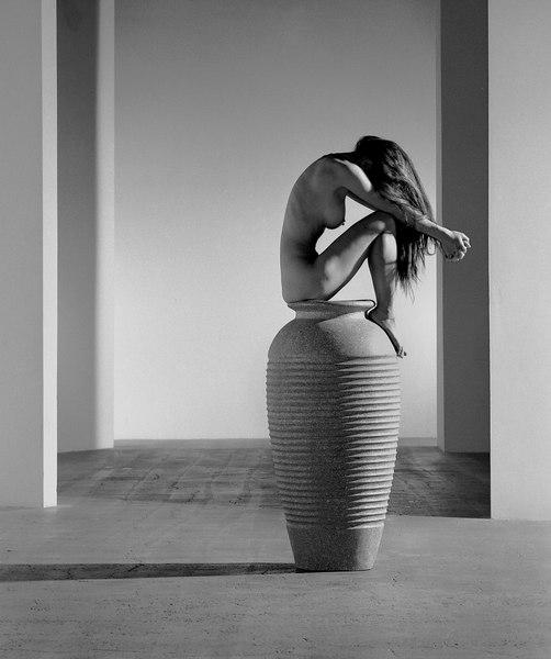 sitting on vase