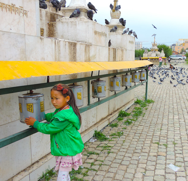 Young Girl Turning Prayer Wheel