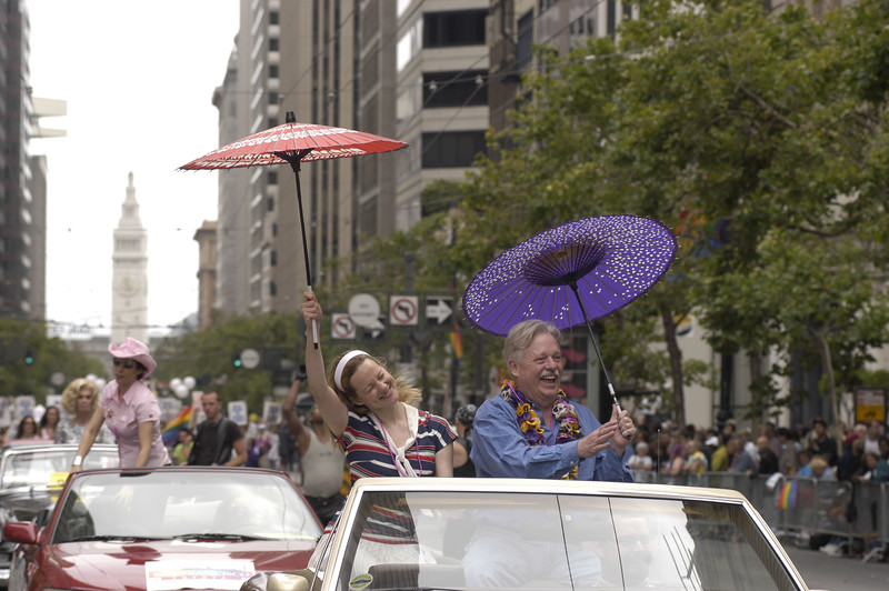 """Celebrity Grand Marshal Armistead Maupin, left and actress Laura Linney wave to the crowd at the 25th Annual San Francisco Gay Pride Parade which was held on Sunday, June 29, 2003 in downtown San Francisco, California. Maupin, a writer is best known for his series """"Tales of the City"""" which was made into a PBS miniseries and eventually into a showtime miniseries. Linney starred as the lead character, Mary Ann Singleton. The parade ran along Market Street beginning at Beale Street in the Financial District and ending at the Civic Center where bandstands and booths were set up for blocks. Over 600,000 people were expected to attend."""
