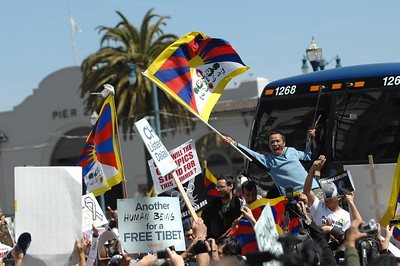 Protestors jumped up on a bus and sat down in front of it until they realized it was an empty bus and a decoy. Meanwhile the Olympic Torch is run through San Francisco on an alternate route amidst thousands of protesters demonstrating both their support for China and the Olympics and against China demanding that the country free Tibet. San Francisco, California. April 9, 2008. (Photo by Jessica Brandi Lifland/ for USA Today)