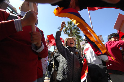Aiying Li yells out in protest, center as the Olympic Torch is run through San Francisco amidst thousands of protesters, San Francisco, California. April 9, 2008. (Photo by Jessica Brandi Lifland/ for USA Today)