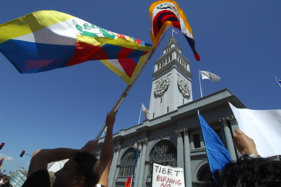 Protesters in front of the San Francisco Ferry Building. An iconic building for the city. The Olympic Torch is run through San Francisco amidst thousands of protesters demonstrating both their support for China and the Olympics and against China demanding that the country free Tibet. San Francisco, California. April 9, 2008. (Photo by Jessica Brandi Lifland/ for USA Today)