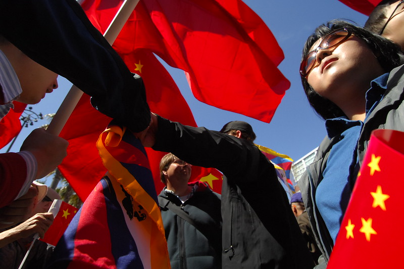 The Olympic Torch is run through San Francisco amidst thousands of protesters demonstrating both their support for China and the Olympics and against China demanding that the country free Tibet. San Francisco, California. April 9, 2008. (Photo by Jessica Brandi Lifland/ for USA Today)