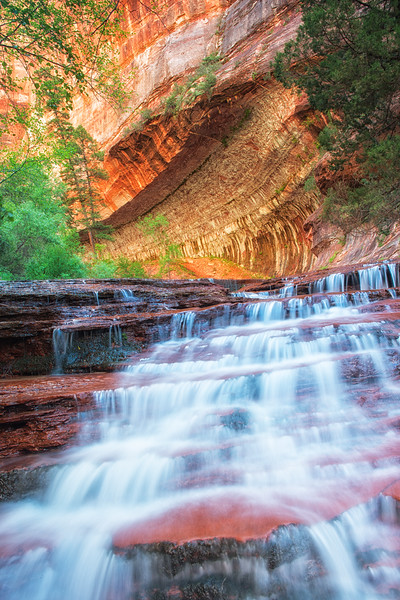 """Waterfalls with Large """"Subway"""" formation in background"""