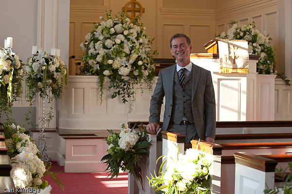Blossoms Events owner, Barry West, surrounded by one of his floral designs