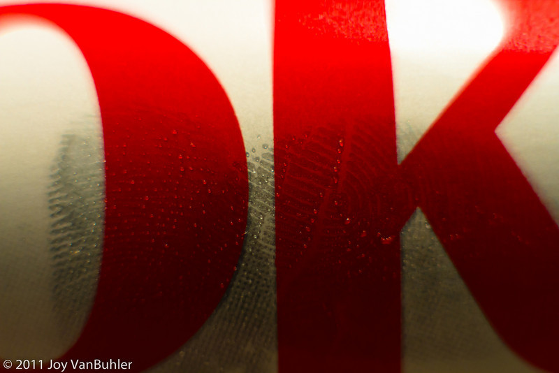 2/9/11 - Experimented with an extension tube on one of my lenses. Got up close to see my fingerprint on a Diet Coke can