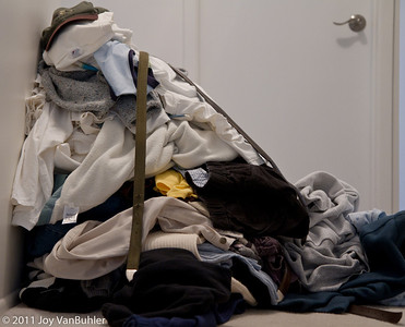 1/2/11 - 1 robe, 2 pjs, 2 sweatpants, 5 pants, 7 shorts, 10 belts, 6 sweatshirts, 6 sweaters, 35 shirts and 1 hat = a busy day of cleaning out closets