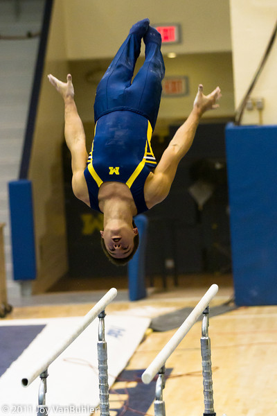 3/19/11 - Went to the last Michigan home match of the season to try out my new 70-200mm lens.  It was great.  I was able to capture a lot of motion.  This is Sam Mikulak on the Parallel Bars.  He is a very impressive athlete.  He won the parallel bars, the floor exercises, the vault and the all around