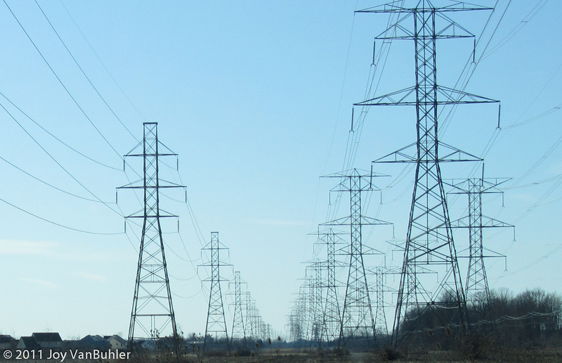 3/28/11 - There is a set of power line towers that cuts a swath through landscape.  While they are a little bit of an eyesore, there  is something about the structure that I like.  I captured this picture as I was driving home from work today.