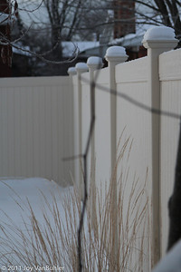 13-Jan-11: I've been doing a lot of close ups lately and I wanted to do something a little bit different.  I noticed the row of columns from my fence this morning and liked the snow on top, so I thought that I would give it a try