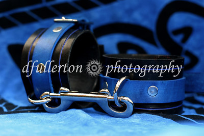 A product photo from Morgan K.'s leatherworking business.  Shown here are wonderful blue manacles.  Photo used with permission from the Larp Garb website.