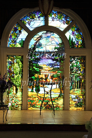 In an adjacent building housing the chapel, an exceptionally large stained glass window was prominent near the altar.
