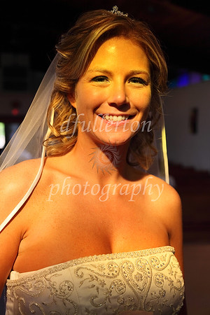 Julie took a couple minutes to bask in the golden sunlight pouring through the eave windows of the church before the reception.