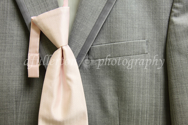 Crisp, textured gray suit jackets accented with pink ties and corsages were the call for this particular wedding.  Very nice I must say.  8-14-10