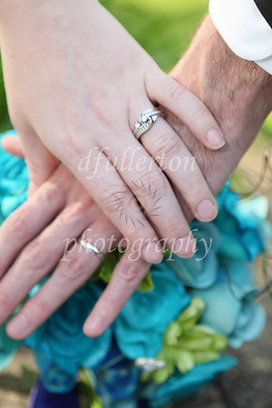 The bouquet made for a wonderful splash of color for the traditional rings photo.