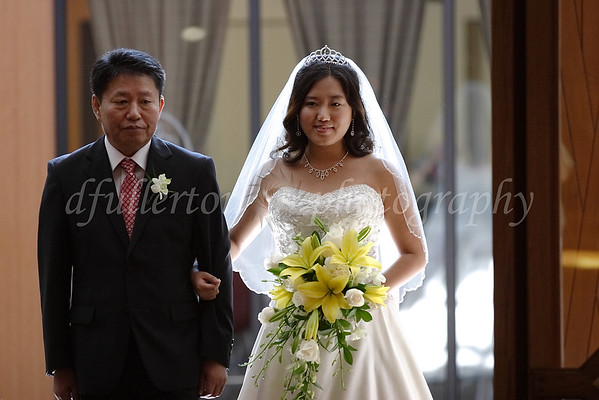 Ahra and her father begin their procession down the aisle on 8-12-11.