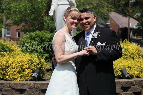Here, Oscar and Sarah posed for a quick photo outside the church in front of a nice landscaping feature.